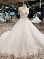 vestido de casamento coreano marfim venda por atacado-Luxo Coreano Vestidos De Casamento 2018 Floral Champagne Marfim Frisado vestido de Baile Vestidos de Noiva Fora Do Ombro Sheer Neck Ilusão de volta Strass