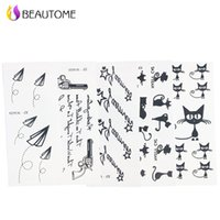 Wholesale Hand Tattoo Gun - Wholesale- 5pcs Mixed Tattoo Stencil Cat Gun and Letter Tattoo Templates Hands Body Henna Tattoo Stencils For Professional Painting