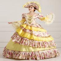 vestidos victorianos amarillos al por mayor-Custom 2016 Retro Amarillo Estampado de flores del siglo XVIII Vestidos victorianos Renacimiento Marie Antonieta Vestidos de bola para las mujeres