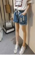 Wholesale Denim Roll High - Women Fashion Shorts Summer 2017 Latest Ripped Drawstring Waist Rolled Hem Blue Twin Pockets Denim Shorts