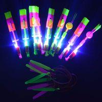 ingrosso fantoccio di natale-All'ingrosso-Fun Kids Amazing Arrow Elicottero Slingshot LED Toy Flying Night Toys Wedding bambini Favore di partito di Natale Capodanno