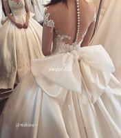 Wholesale Short Wedding Dress Big Bows - Vintage Ball Gown Ivory Wedding Dresses with Illusion Short Sleeve Sheer Back Button Big Bow Satin 2017 Lace Bridal Wedding Gowns Custom
