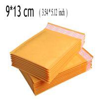 caixa redonda de embrulho venda por atacado-Atacado-11 * 13 cm 100 Pcs Amarelo Kraft Envelope Bolha Poli Mailer Acolchoado Envelopes Sacos De Correio Bulle Presente Saco Para O Partido