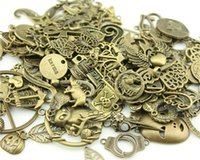 Wholesale Mixed Zinc Alloy Gold - Wholesale- RANDOM mix styles 50g (about 20~50pcs) antique bronze color zinc alloy charms (you may get some charms not in the picture!)