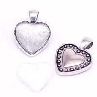 ajustes del corazón de plata al por mayor-Sweet Bell 10 set Cameo Heart cabochon Ajustes Fit 20mm dia Antique silver Foto Encanto colgante + Cabujones de cristal claro D0881-1