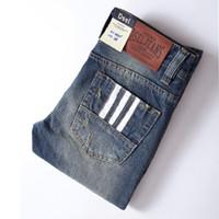 Wholesale Classic Patterns - Wholesale- 2017 High Quality White Button Jeans Men New Famous Brand Dsel Jeans Ripped Trousers Slim Denim Classic Blue Mens Jeans T9003