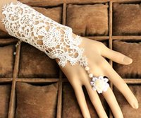 Wrist Length black pearl gloves - New Design Lace Pearl White Black Wedding Gloves Bridal Gloves Bow Fingerless Wrist Length Glove Wedding Accessories