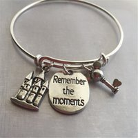 "Wholesale american castles - 12pcs Bracelet with castle mouse key and stamped ""remember the moments"""