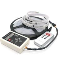 ingrosso controller rgb a strisce led-Striscia di magia LED di colore di sogno 6803 CI 5050 RGB SMD 150 LED 5M impermeabile 133 colori con il regolatore DC12V