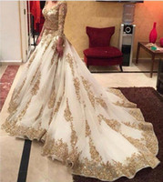 Wholesale Nude Embellished Gown - V-neck Long Sleeve Arabic Evening Dresses Gold Appliques embellished with Bling Sequins 2017 Trendy Sweep Train Prom Dresses Formal Gowns