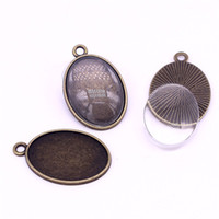 Sweet Bell 10set Antique Bronze Oval Pingente Blanks Jóias Findings Fit18 * 25mm dia Fit Jóias Diy + Clear Glass Cabochon A1453-1