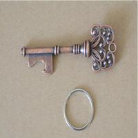 ingrosso portachiavi di novità-HouseHolds Novelty Mini UK Suck KeyChain Portachiavi Apribottiglie in metallo Apribottiglie in acciaio Coca può aprire strumento con anello