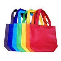 beutelanzeige großhandel-60 stücke 26 * 33 * 1 cm vlies Wiederverwendbare Kinder Tragen Einkaufen Lebensmittelgeschäft Einkaufstasche für Mitbringselanzeigen (Zufällige Farbe)