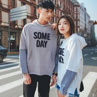 Wholesale New couple shirt fake two pieces of loose large size hooded coat