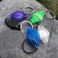 led multicolore achat en gros de-Multi-couleur LED Keychain Lampes de poche LED porte-clés mini led porte-clés lumière 7 couleurs 1000 PCS O129