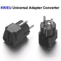 adaptadores elétricos universais venda por atacado-Alta Qualidade Universal DA UE Coréia Do Sul Plug Adapter Converter EUA REINO UNIDO Para AC Europeu Tomadas De Energia Tomadas Elétricas Preto