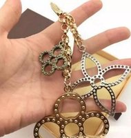 Wholesale Rhinestone Ball Dust - Charm Key Holder flowers perforated Mahina leather Key Holder TAPAGE BAG CHARM M65090 Bag comes with Box dust bag