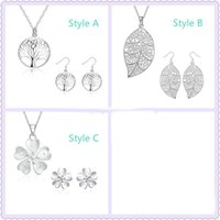 Wholesale Cheap Xmas Trees - Cheap 925 Silver Plated Living tree of life Jewelry Set Leaf Heart Flower Key Pendant Necklace and Earrings For Women Xmas gift