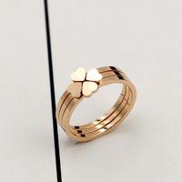 oro han al por mayor-La combinación tres en uno de Han del anillo de oro rosa de titanio con trébol de cuatro hojas y el anillo de tres piezas para el corazón de la mujer