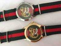 Wholesale Glass Tigers - Fashion brand tiger style Women's girl nylon strap quartz wrist watch GU07