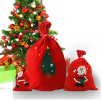 Wholesale gift factory stuff toys - Christmas Gift Bag Santa Backpack Christmas Decoration Candy Bag Factory Direct Non woven Gift Bag a variety of styles mixed
