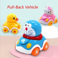 bebek itme toptan satış-Hello kitty Bebek Atalet Araçlar Doraemon Push ve Git Toddlers Mini Sürtünme Plastik Powered Araba Oyuncak Hediye Çocuk Çocuk oyuncakları