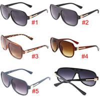 óculos de sol grátis venda por atacado-Populares óculos de sol de ciclismo mulheres UV400 óculos de sol moda mens óculos de sol óculos de condução equitação vento espelho legal óculos de sol frete grátis