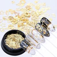 fatia de ouro venda por atacado-1box prego de ouro Arte de Natal decoração de metal Fatias do floco de neve da flor da estrela de Bell Sequins oco Quadro Studs Adesivos Manicure Acessório Novo