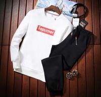 chándales de tendencia al por mayor-Chándal de los hombres ropa deportiva casual de dos piezas 2018 otoño nuevo suéter traje de los hombres de impresión de Corea tendencia traje deportivo casual