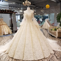Wholesale shining wedding dresses resale online - 2019 Latest Lebanon Wedding Dresses Shining Sequins Crystal Pearl Illusion V Neck Backless Long Tulle Sleeve Pattern Applique Bridal Gowns