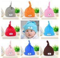 Wholesale black hair kid - Newborn Baby Ear Protection Cap Cute Bear Air conditioned Room hat Baby Hair Bows Hat Spring Autumn Winter Kids hat Many color MZ04