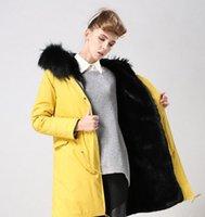 damen gelb parka großhandel-Meifeng Marke Mode schwarz Waschbärpelz trimmen Damen Schnee Mäntel schwarz Kaninchen Pelz Futter gelb lange Parkas