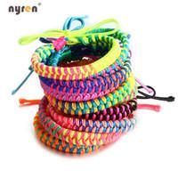 ingrosso braids di amicizia-Hot 100 PCS / Lot Colorful Rainbow tessuto Handmade di corda intrecciata del braccialetto di amicizia della Boemia della spiaggia per i monili delle donne