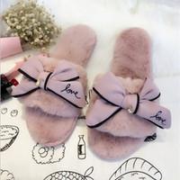 ingrosso flip flop invernale-Flip flop di marca famosa pelliccia dolce fiocco in pizzo arco scivola donne sandali invernali designer caldo e accogliente pantofole casa con fiore