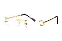 diseñadores de marcos ópticos al por mayor-Gafas de sol de moda Gafas de montura sin montura Gafas de sol ópticas Marco de piernas de metal Gafas de marca con estuche y caja