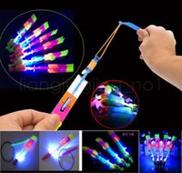 Wholesale flying arrow toys rocket online - led Amazing flying Light Arrow Rocket Helicopter Flying Toy Party Fun Gift Elastic flshing gow up roket chirstmas toys GGA519