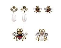 eski takı aksesuarları toptan satış-Kadınlar Marka Moda Sevimli kristal arılar damızlık küpe kadın vintage inci küpe emaye hayvan takı düğün brincos aksesuarları