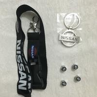 peugeot car key shell substituição venda por atacado-Liga de zinco keychain + cordão + tampões de válvula de haste para nissan altima maxima 350z 370z