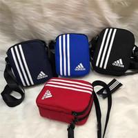 bolsa de mensajero de nylon de las mujeres al por mayor-Bolsos de hombro de la marca con LetterStripes Impreso diseñador Messenger Bag Hombres hombro de lujo Cross-Body Bag Zipper para mujeres