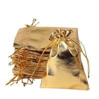 ingrosso sacchetti di regalo d'argento dell'organza-50pcs 7 * 9cm oro argento sacchetti regalo di Natale sacchetti di lamina metallica sacchetti di organza sacchetti regalo di favore di cerimonia nuziale