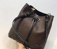 cubo de cordón de cuero al por mayor-2019 Moda bolso de cubo de cuero genuino de las mujeres famosas bolsos con cordón de impresión de flores bolso crossbody