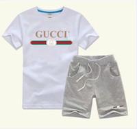 años de ropa casual al por mayor-Los pantalones de la camiseta del bebé del diseñador de la primavera de lujo dos-piec 3-7 años de la ropa de los niños de la marca de los niños Los sistemas de la ropa del algodón de los niños 2pcs