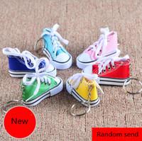 joyería llavero al por mayor-3D Novedad Canvas Sneaker Tenis Zapato Llavero Llavero Party Jewelry 100 unids colores al azar enviar YYA1069