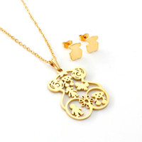 Wholesale beautiful china girls - New Trendy Women Party Jewelry set Beautiful 18k gold hollow heart, boy and girl charms jewelry earring necklace set bears fashion sale