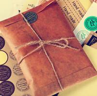 papel sobres aire al por mayor-Comercio al por mayor retro estilo de papel de Kraft marrón envolvente postal invitación carta de papelería bolsa de papel Vintage Air Mail regalo sobre 400pcs