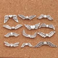 alas de angel tibetano al por mayor-Variedad de alas de ángel de plata tibetana mezclada 120 unids / lote 12 estilos espaciadores joyería DIY aleación suelta perlas LM46