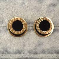 ohrring gold hochzeit großhandel-Außenhandel ornamente großhandel titan stahl runde schwarz weiß tropft öl brief Ohrring 18 karat gold marke hochzeit mode ohrringe