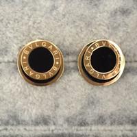 siyah beyaz ticaret toptan satış-Dış ticaret süsler toptan titanyum çelik yuvarlak siyah beyaz damlayan yağ mektubu Küpe 18 K altın marka düğün moda Kulak halkaları