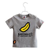 kleines mädchen sommert-shirt großhandel-Luxus Logo Buchstabe Kinder T-shirts Sommer Shorts Ärmel Affe Banane Kleine Mädchen Tops Rot Weiß Jungen Tees