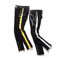 ingrosso pantaloni gialli per gli uomini-2017 NUOVO TOP kanye west bianco giallo splice stripes uomo pantaloni hip hop tasca pantaloni laterali cerniera pantaloni sportivi casuali M-XXL